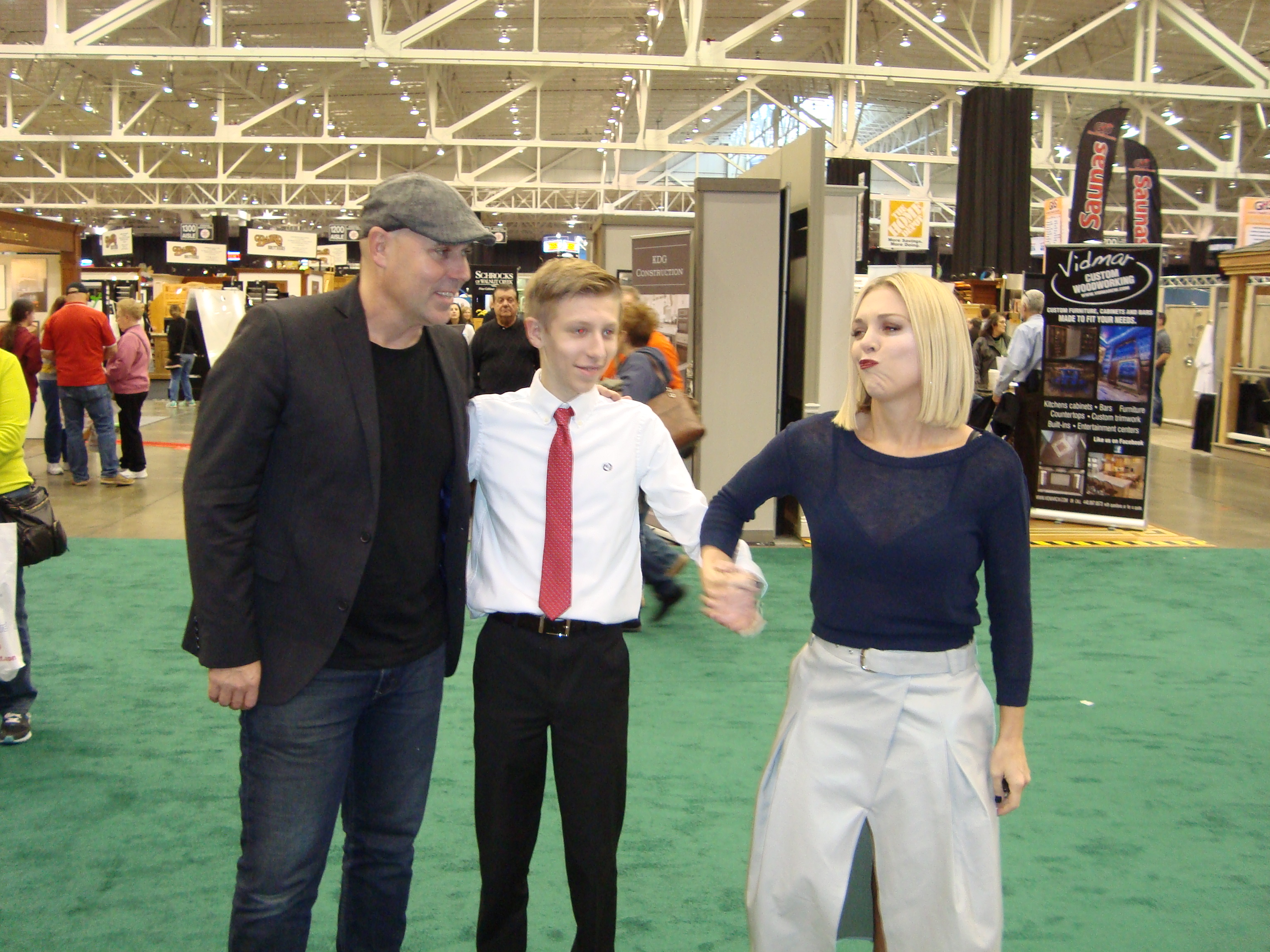 Dave and Kortney Wilson of the HGTV show Masters of Flip shake hands with Connor Reis at the IX Center.