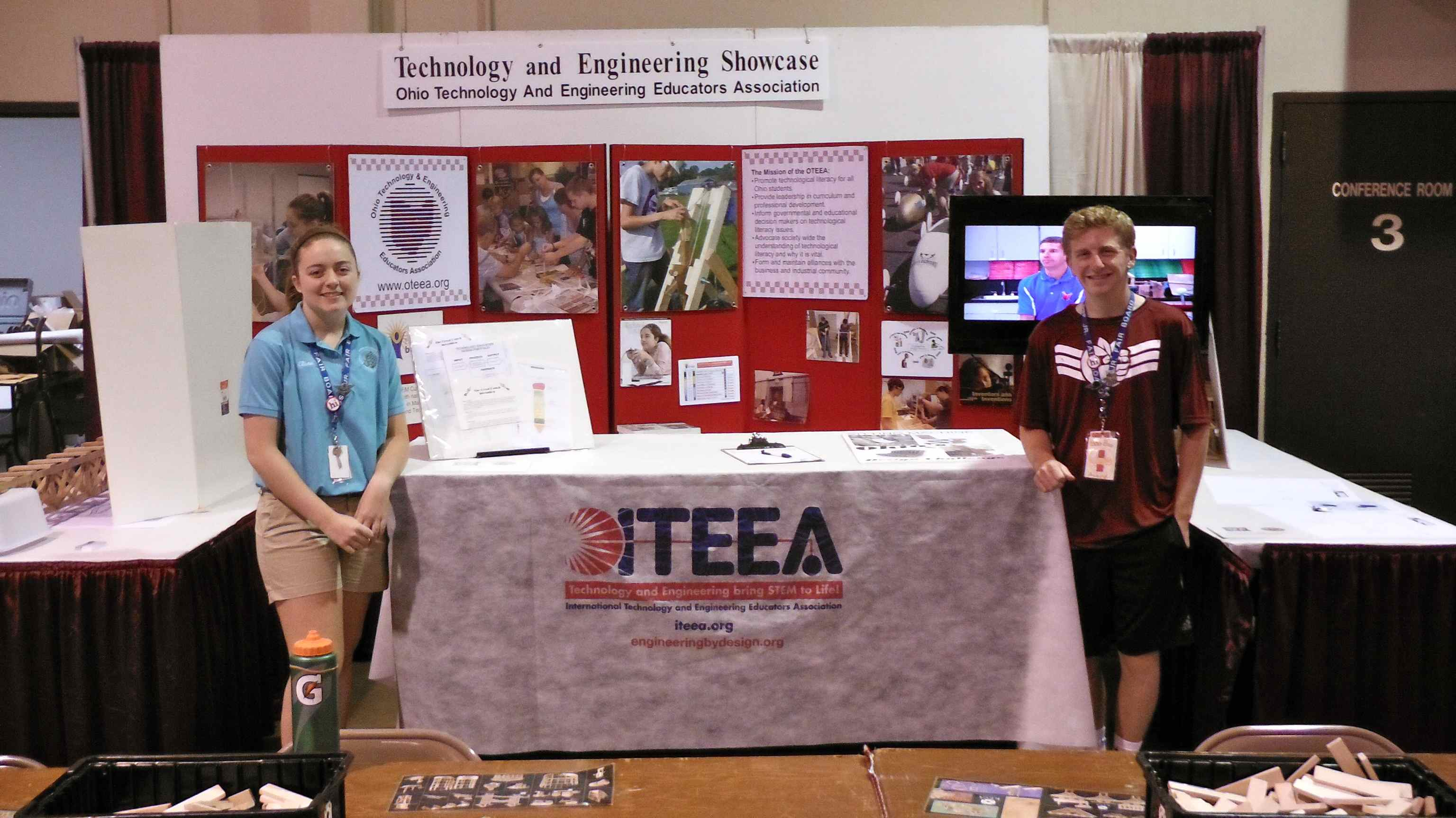 Junior Fair Board Ambassadors Elise Kennedy and Nicholas Button take a break at the ITEEA booth at the Ohio State Fair - Summer 2015.