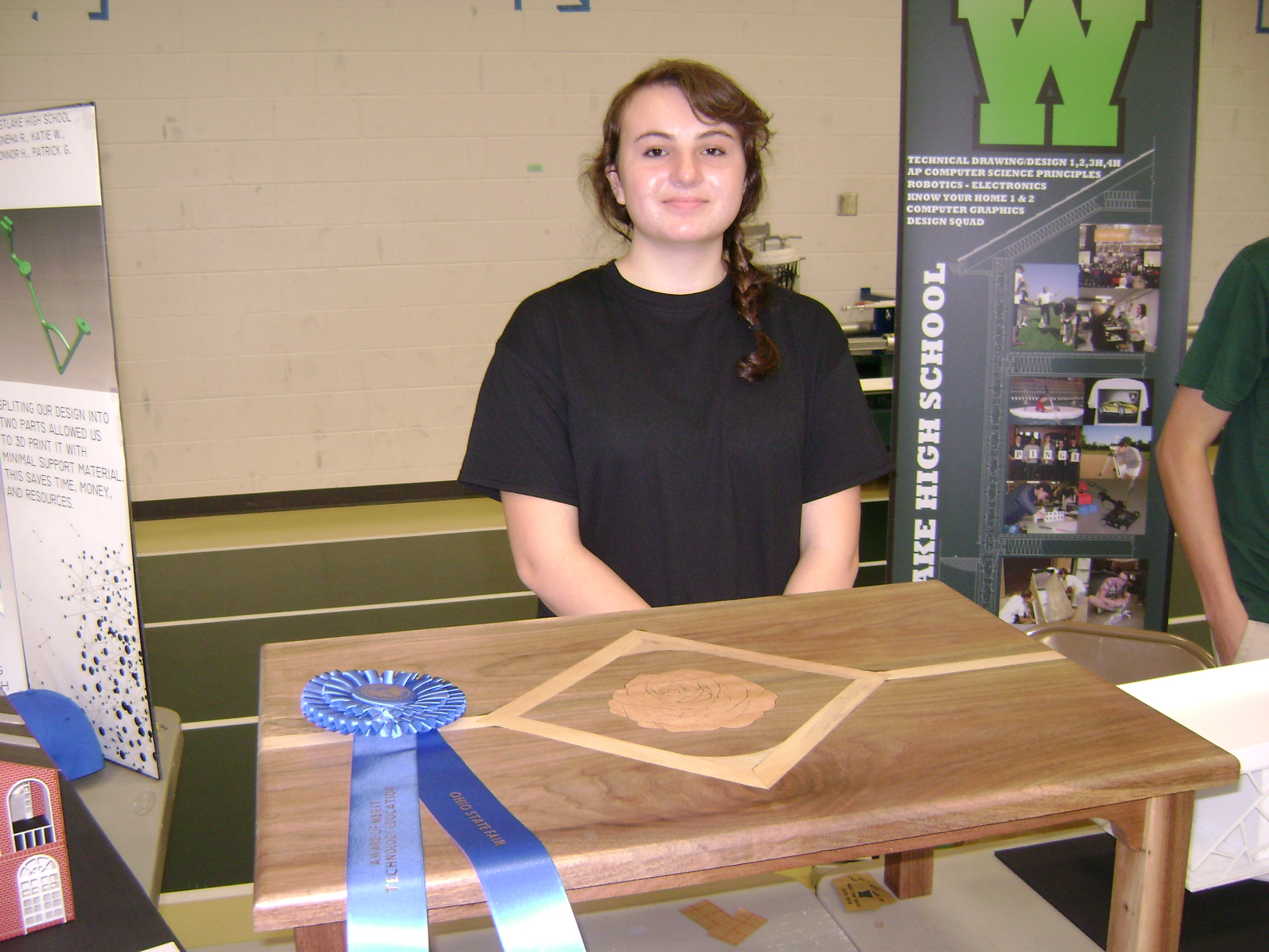 Katie Willi - designed a walnut table with a laser engraved rose on top