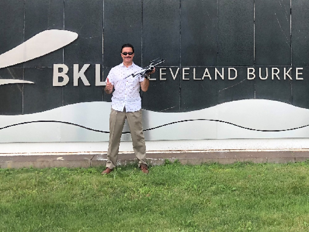 Mr. Kutz in front of Burke Lakefront Airport after passing his Part 107 Remote Pilot test 7-5-18