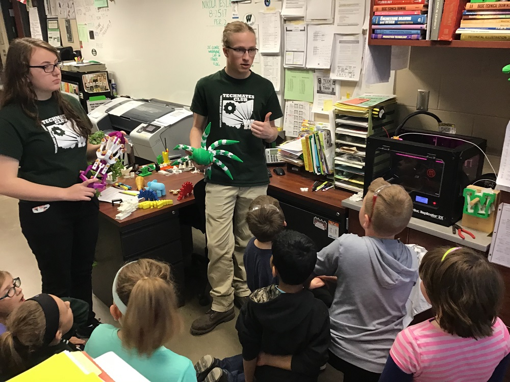 TechMates Katie WIlli and Ethan Simon presenting 3D printing and laser engraving to the Bassett elementary 4th graders at the MAKE event